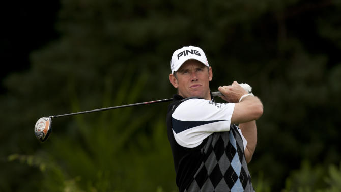 England's Lee Westwood hits a drive off the 2nd tee during a practice round at the Royal Lytham & St Annes golf club before the forthcoming British Open Golf tournament, Lytham St Annes, England, Monday July 16, 2012. (AP Photo/Jon Super)