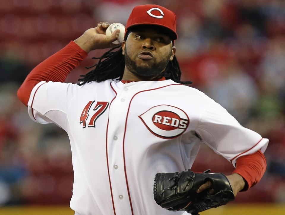 Cincinnati Reds starting pitcher Johnny Cueto throws to a New York Mets batter in the first inning of a baseball game, Monday, Sept. 23, 2013, in Cincinnati. (AP Photo/Al Behrman)