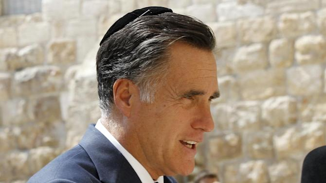 Republican presidential candidate and former Massachusetts Gov. Mitt Romney wears a yarmulke as he visits the Western Wall in Jerusalem, Sunday, July 29, 2012. (AP Photo/Charles Dharapak)