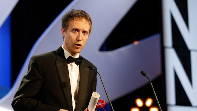 Hungarian director Laszlo Nemes accepts the Grand Jury prize at Cannes