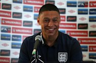Arsenal winger Alex Oxlade-Chamberlain does not see himself as an England regular just yet