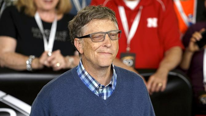 Microsoft co-founder Bill Gates reacts after hitting as he plays table tennis during the Berkshire Hathaway annual meeting weekend in Omaha, Nebraska