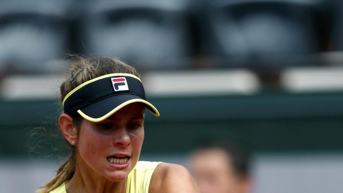 Julia Goerges of Germany plays a shot to Caroline Wozniacki of Denmark during their women's singles match at the French Open tennis tournament at the Roland Garros stadium in Paris
