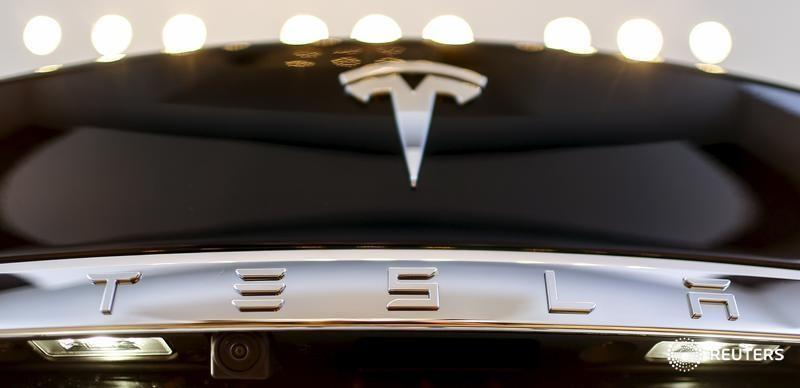 Tesla expects to become profitable in 2016, shares surge