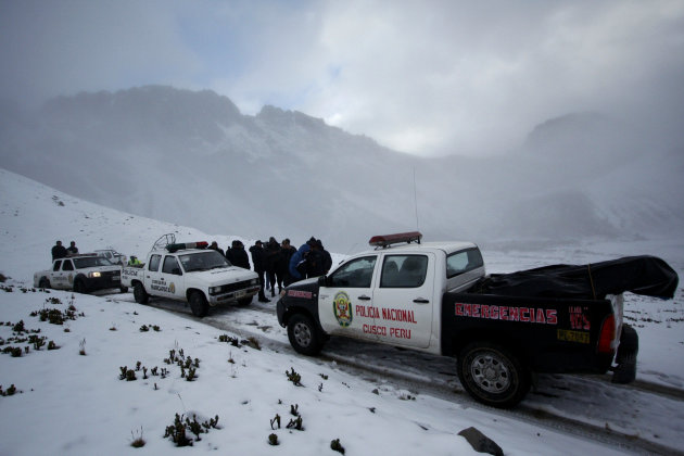 Police officers gather before searching for a missing helicopter in Cuzco, Peru, Thursday, June 7, 2012. Snow and fog impeded efforts Thursday to locate a helicopter that went missing in Peru's highlands with 14 people aboard, including eight South Koreans and three Europeans. Authorities said the aircraft's emergency beacon indicated it was on rugged terrain. (AP Photo/Juan Diego Contreras)