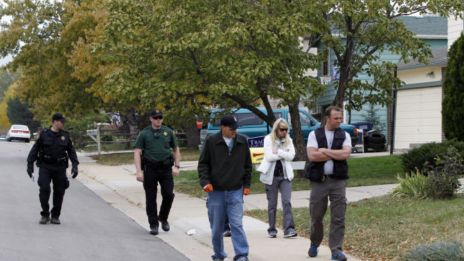 Police walk the streets looking for clues in the search for ten-year-old Jessica Ridgeway near her home in Westminster, Colo., on Wednesday, Oct. 10, 2012. The youngster has been missing since she left her home Friday morning on her way to school. (AP Photo/Ed Andrieski)