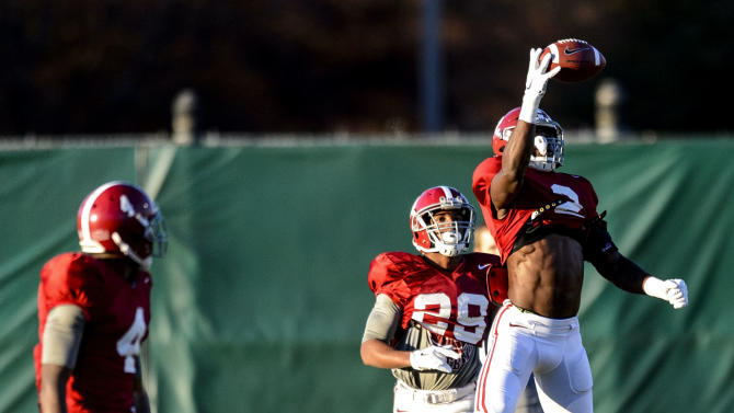 Alabama defensive back Tony Brown (2) makes a one-handed grab in INT drills, followed by Alabama defensive back Marlon Humphrey (29) as he works through drills during Alabama football practice, Wednesday, Nov.26, 2014, at the Thomas-Drew Practice Facility in Tuscaloosa, Ala. Alabama defensive back Eddie Jackson (4) is at left.(AP Photo/AL.com, Vasha Hunt) MAGS OUT