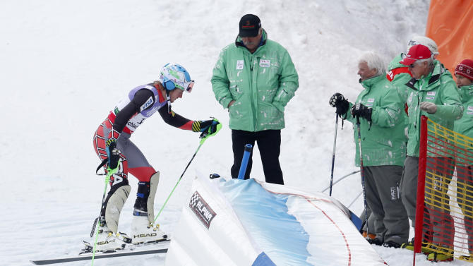 United States'TedLigety leaves the slope after missing a gate during the first run of the men's slalom at the Alpine skiing world championships in Schladming, Austria, Sunday, Feb.17,2013. (AP Photo/Matthias Schrader)