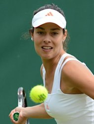 Serbia's Ana Ivanovic plays a forehand during her first round women's singles match against Spain's Maria Jose Martinez Sanchez on day three of the 2012 Wimbledon Championships tennis tournament at the All England Tennis Club in Wimbledon, southwest London