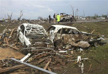 Destroyed cars are seen after a huge tornado struck Moore, Oklahoma