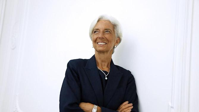 IMF chief Christine Lagarde poses on the sideline of a press conference, on August 27, 2014 at her lawyer's office in Paris
