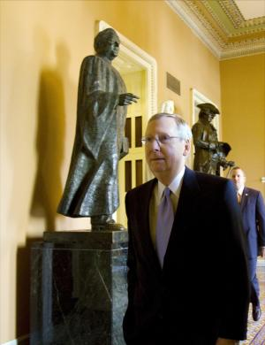 Senate Minority Leader Mitch McConnell, R-Ky., walks to the Senate floor on Capitol Hill in Washington on Wednesday, July 20, 2011.(AP Photo/Harry Hamburg)