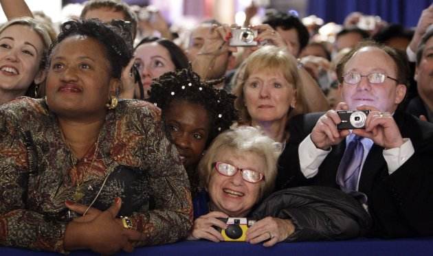 FILE - Dr. Ruth Westheimer, center, in the front-row watches President Barack Obama and first lady Michelle Obama at the Western Inaugural Ball in Washington, in this Jan. 20, 2009 file photo. The sideline events throughout inauguration weekend are the big draws for advocates and lobbyists looking to rub elbows with lawmakers and administration officials. The events at restaurants and hotels, museums and mansions are opportunities for anyone willing to write a check to turn a night out into a chance to build a Rolodex of Washington&#39;s powerbrokers. (AP Photo/Pablo Martinez Monsivais, File)