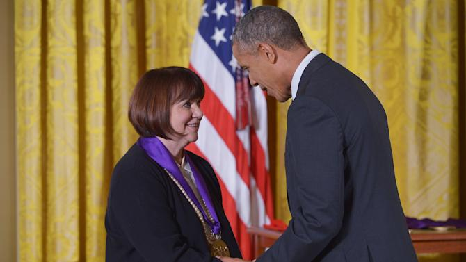 US President Barack Obama presents the National Medal of Arts to US singer Linda Ronstadt during a ceremony in the East Room of the White House on July 28, 2014 in Washington, DC