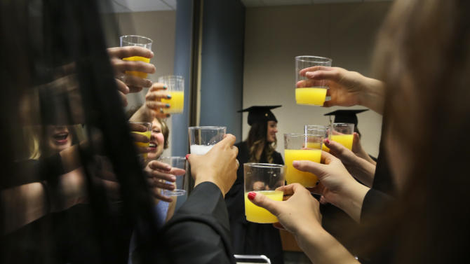 University of Minnesota, Rochester students toast one another before their graduation ceremony at Mayo Civic Center, Saturday, May 18, 2013, in Rochester, Minn. (AP Photo/The Star Tribune, David Joles) MANDATORY CREDIT; ST. PAUL PIONEER PRESS OUT; MAGS OUT; TWIN CITIES TV OUT.