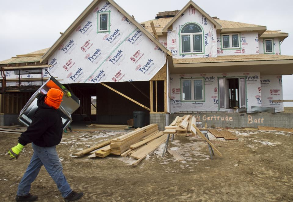 A contractor carries heating ducts to a house under construction in Gretna, Neb., Tuesday, Nov. 30, 2010. Construction spending rose in October for the second straight month as residential building gains.(AP Photo/Nati Harnik)