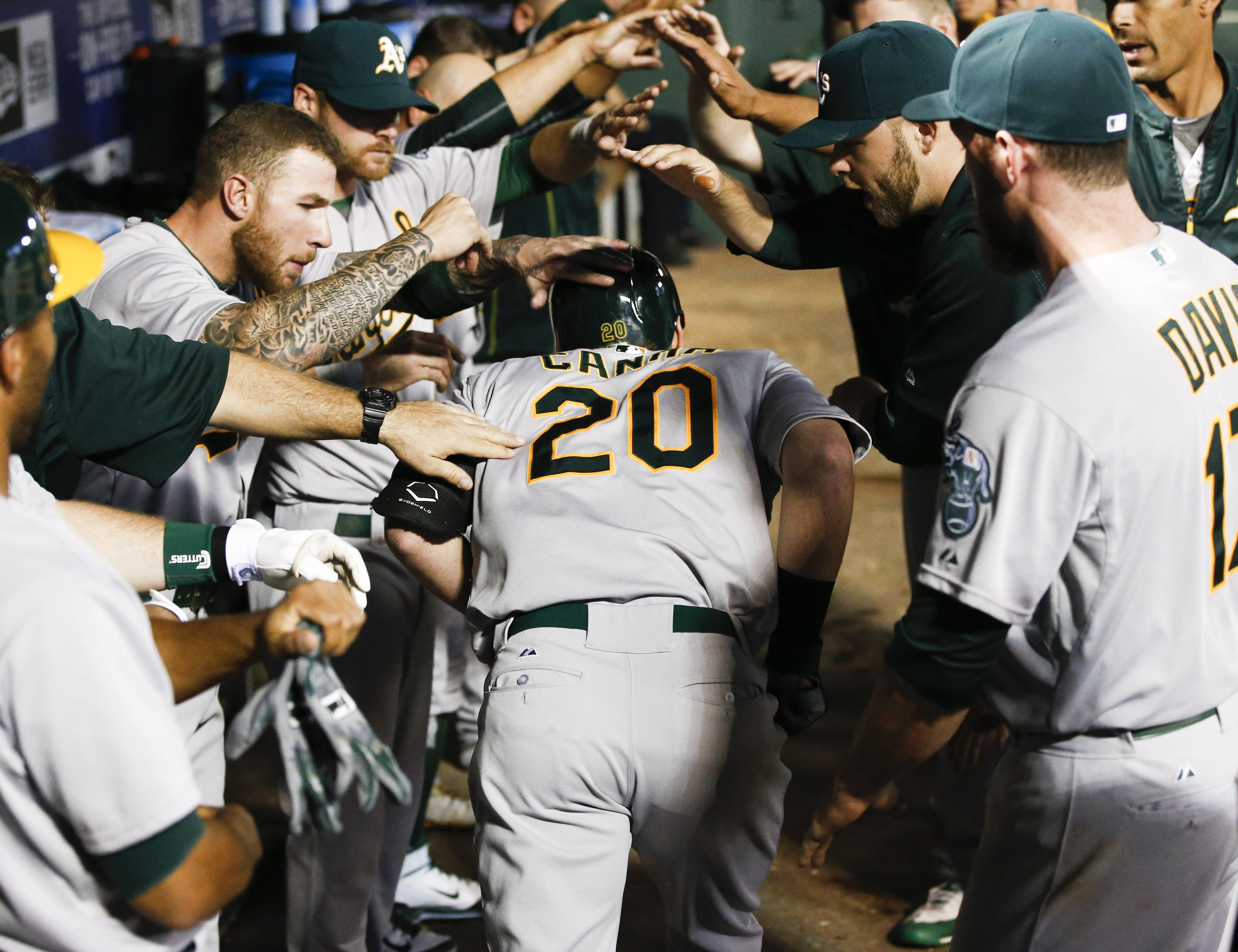 Canha leads 7-run 8th inning for A's in 7-5 win over Rangers