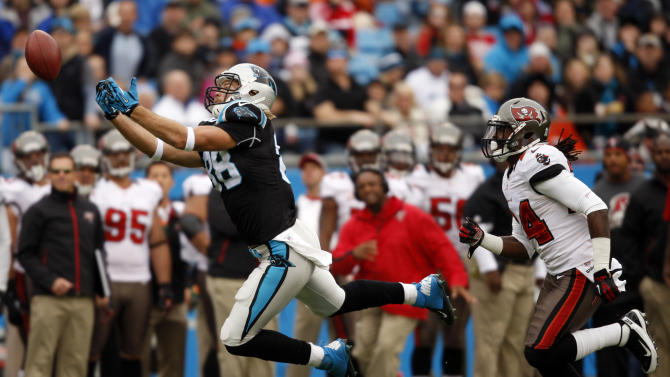 Carolina Panthers' Greg Olsen (88) misses a catch as Tampa Bay Buccaneers' Mark Barron (24) defends during the first half of an NFL football game in Charlotte, N.C., Sunday, Nov. 18, 2012. (AP Photo/Nell Redmond)