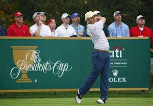 International team member Oosthuizen of South Africa tees off on the 16th hole during the continuation of his rain-delayed foursome match at the 2013 Presidents Cup golf tournament at Muirfield Village Golf Club in Dublin, Ohio