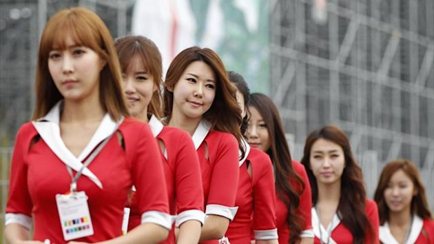 Grid girls arrive at the paddock prior to the South Korean F1 Grand Prix at the Korea International Circuit (Reuters)