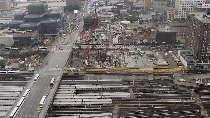 This July 26, 2012 photo shows an aerial view of the Hudson Yards in New York, a $15 billion project that will soon start rising on land along the Hudson River. Bounded by 10th and 12th avenues and West 30th and 33rd streets, it is one of only two pieces of Manhattan land still available for major development. An $800,000 platform will cover the field of open tracks that will continue to be used by the Long Island Rail Road, stretching under the Pennsylvania Station transportation hub. (AP Photo/ Fay Abuelgasim)