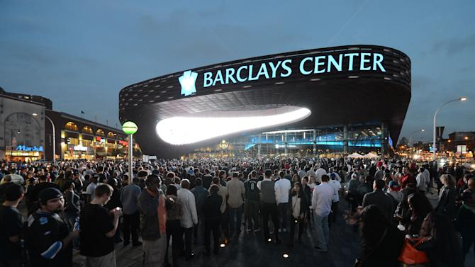FILE - This Sept. 28, 2012 file photo shows people arriving for the first of eight Jay-Z shows at the Barclays Center in the Brooklyn borough of New York. A person familiar with the situation says the New York Islanders have struck a deal to move to Barclays Center as early as 2015. The person was not authorized to discuss the situation prior to an afternoon announcement, Wednesday, Oct. 24, 2012,  and spoke to The Associated Press on condition of anonymity.(AP Photo/Henny Ray Abrams, File)