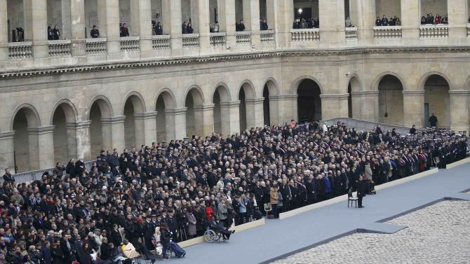 People wounded in the Paris attacks attend a ceremony to pay a national homage to the victims of the Paris attacks at Les Invalides monument in Paris