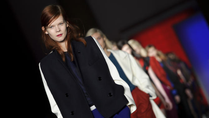 A model wears a design from the Paul Smith collection during London Fashion Week, Sunday, Feb. 17, 2013, London. (Photo by Jonathan Short/Invision/AP)