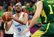 French guard Tony Parker (left) vies with Lithuanian forward Linas Kleiza during the men's preliminary round basketball match of the London 2012 Olympic Games at the basketball arena in London. Parker scored 27 points and France took a big step toward reaching the medal playoffs in the Olympic men's basketball tournament by defeating Lithuania 82-74