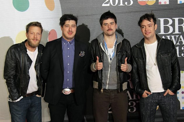 From left, Ted Dwane, Marcus Mumford, Country Winston, and Ben Lovett of British band Mumford and Sons seen arriving at the BRIT Awards 2013 at the o2 Arena in London on Wednesday, Feb. 20, 2013. (Pho