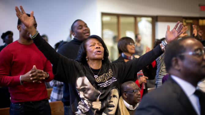 Sheneal Davis, of McDonald, Ga., joins in a song during the annual Dr. Martin Luther King Jr. holiday service at the Ebenezer Baptist Church, Monday, Jan. 21, 2013, in Atlanta. The nation will honor civil rights leader Martin Luther King Jr. on Monday, the same day as it celebrates the inauguration of the first black president to his second term. (AP Photo/David Goldman)
