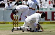 South Africa's Dean Elgar (L) tries to run out New Zealand batsman Jeetan Patel in the first Test in Cape Town on January 4, 2013. New Zealand were blown away for 45 in the first innings of the first Test on the way to defeat by an innings and 27 runs