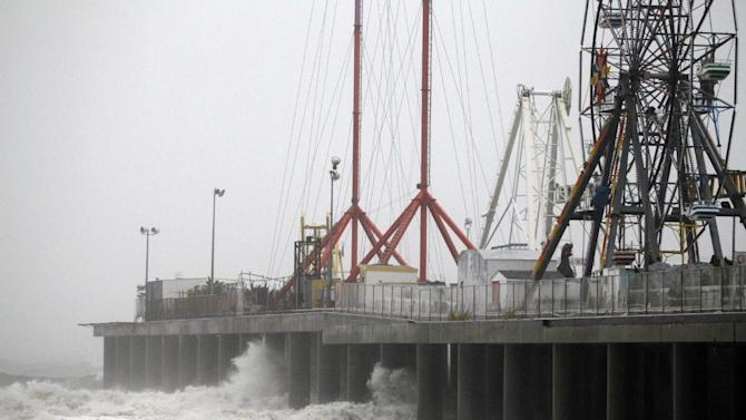 FILE - In this Aug. 27, 2011, file photo, waves crash against the Steel Pier in Atlantic City, N.J. as Hurricane Irene approached the northeast. Two years before Irene, 100 scientists and engineers met to sketch out a bold defense: Massive, moveable barriers to shield New York City from a storm-stirred sea. One strategy entailed an estimated $9.1 billion set of barriers at three critical points around the city's waterways. The network would protect Manhattan and parts of the four outer boroughs and New Jersey, but not some vulnerable swaths of Brooklyn and Queens. (AP Photo/Alex Brandon, File)