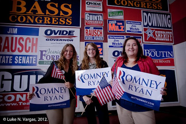 Romney supporters pose with campaign signs after a rally featuring Paul Ryan in Derry, N.H., on Sept. 29, 2012. (Luke N. Vargas, Political Courier Med...