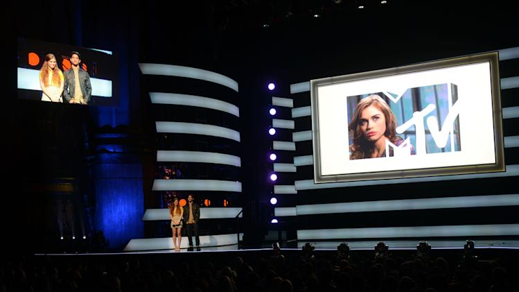"From left, Holland Roden and Tyler Posey of ""Teen Wolf"" presenting at the 2013 MTV Upfront, on Thursday, April 25, 2013 at the Beacon Theater in New York. (Photo by Scott Gries/Invision/AP Images)"
