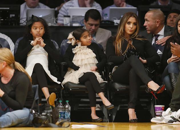 Vanessa Bryant, right, wife of Los Angeles Lakers' Kobe Bryant, sits with their daughters Natalia Diamante Bryant, left, and Gianna Maria-Onore Bryant, center, as the Lakers play the Toronto Rapto