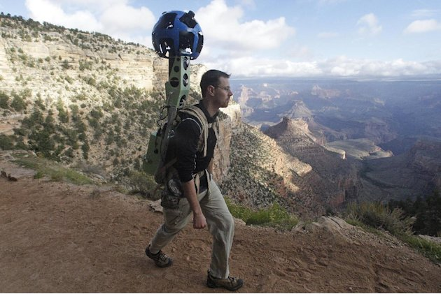 In this Monday Oct. 22, 2012, photo, Google product manager Ryan Falor walks with the Trekker during a demonstration for the media along the Bright Angel Trail at the South Rim of the Grand Canyon Nat
