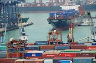 Tugs maneouver a container ship into position to be unloaded at the Kwai Tsing Container Terminals in Hong Kong, 2011. China and South Korea said they would formally begin negotiations on a free-trade agreement this month, Chinese state media reported, with the talks expected to take two years