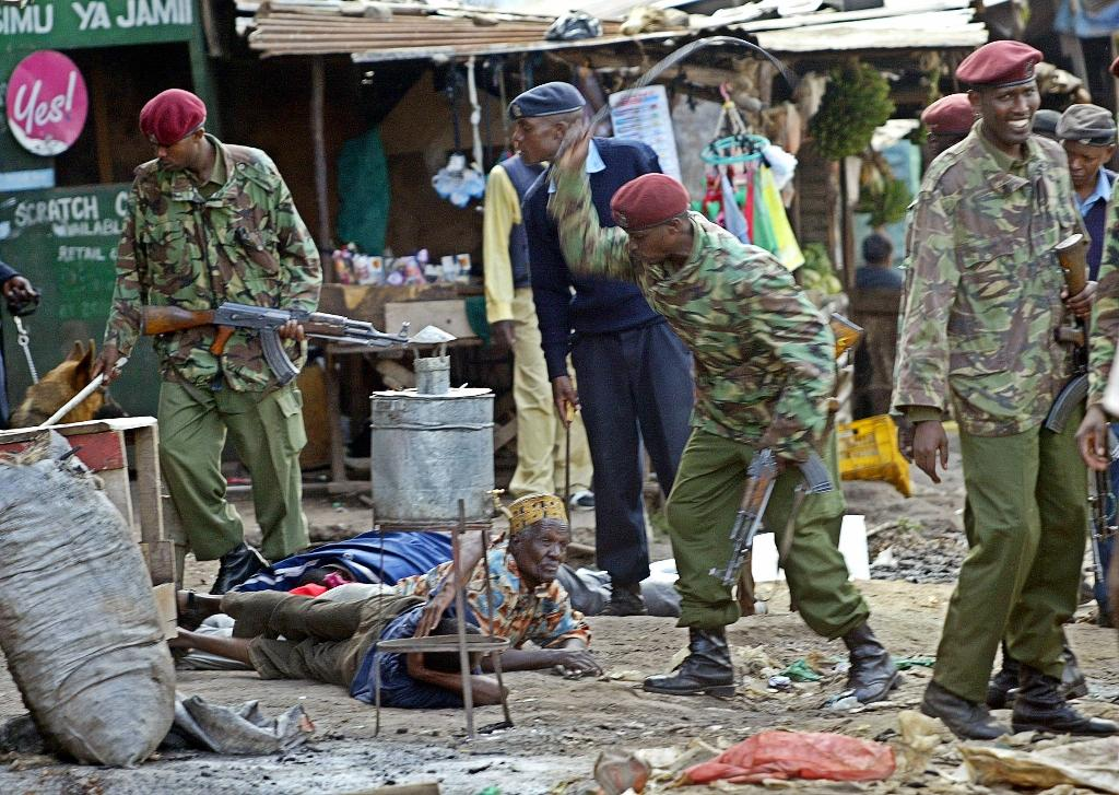 Kenya police probe whipping pictures after outcry