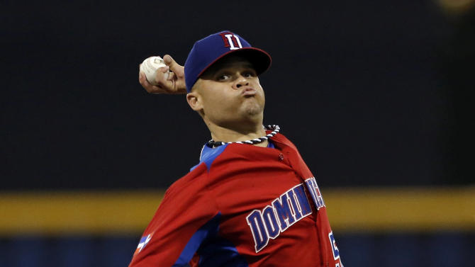 Dominican Republic starting pitcher Wandy Rodriguez throws in the first inning of the World Baseball Classic first round game against Puerto Rico in San Juan, Puerto Rico, Sunday, March 10, 2013. (AP Photo/Andres Leighton)