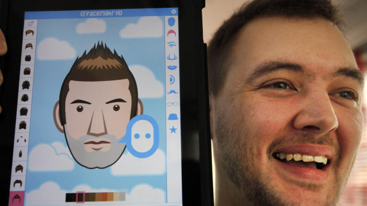 "In this Oct. 19, 2010 photo, Dadako Studio Japan President Hawken King, a 32-year-old Briton, shows an avatar application he developed for iPhone users at his office in Tokyo, Japan. His 115 yen ($1.40) ""Facemakr"" allows people to easily and smoothly create avatars, or facial likenesses, on iPhone's touch panel, choosing images of noses, eyes and hairstyles. (AP Photo/Itsuo Inouye)"