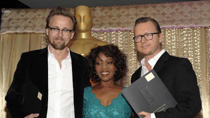 "From left to right, director Joachim Roenning, actress Alfre Woodard and director Espen Sandberg pose together during the The Oscars Foreign Language Film Award Directors Reception at The Academy of Motion Picture Arts and Sciences in Beverly Hills, Calif. on Friday, Feb. 22, 2013. Roenning and Sandberg's feature film ""Kon-Tiki"" is nominated for Best Foreign Language Film. (Photo by Dan Steinberg/Invision/AP)"