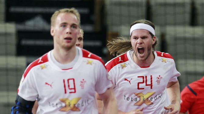 Hansen and Toft Hansen of Denmark celebrate a goal against Iceland during their round of 16 match of the 24th men's handball World Championship in Doha