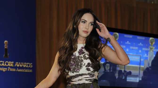 Presenter Megan Fox arrives onstage to help announce nominations for the 70th Annual Golden Globe Awards, Thursday, Dec. 13, 2012, in Beverly Hills, Calif. The Golden Globe Awards will be held on Sunday, Jan. 13 at the Beverly Hilton Hotel in Beverly Hills. (Photo by Chris Pizzello/Invision/AP)