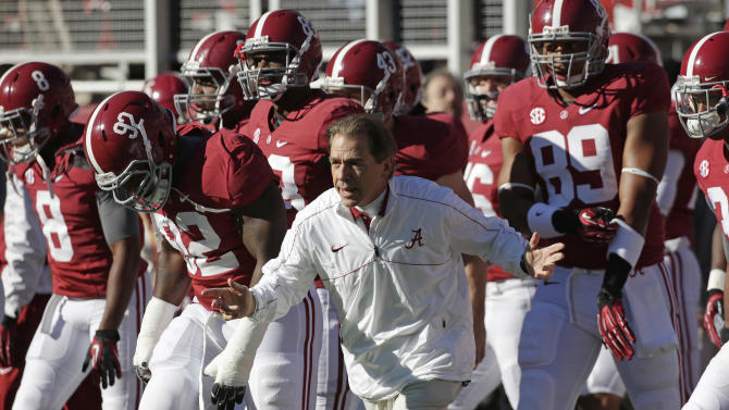 Alabama coach Nick Saban leads his team onto the field prior to their NCAA college football game against Auburn at Bryant-Denny Stadium in Tuscaloosa, Ala., Saturday, Nov. 24, 2012. (AP Photo/Dave Martin)