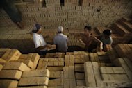 Myanmar workers layi bricks to dry at a brick factory on the outskirts of Yangon. The World Bank will inject $245 million of aid into Myanmar to support its reform drive, resuming assistance for the former pariah nation after a quarter-century absence
