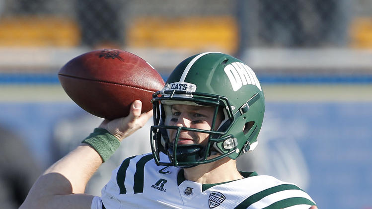Ohio's Tyler Tettleton throws a pass against Kent State during the third quarter of an NCAA college football game Friday, Nov. 23, 2012, in Kent, Ohio. Kent State won 28-6.  (AP Photo/Ron Schwane)