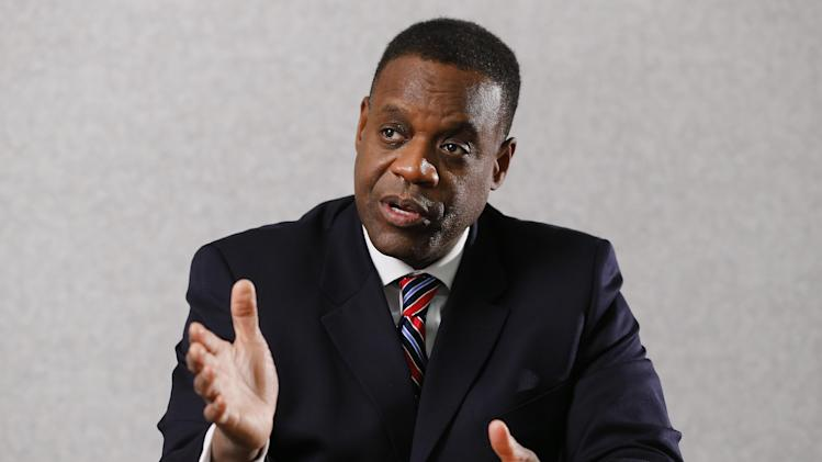 Detroit Emergency Manager Kevyn Orr speaks during an interview with The Associated Press in Detroit, Thursday, Dec. 12, 2013. Orr told The AP that the pensions of Detroit city retirees won't be immune to cuts despite a private effort to raise $500 million to help the city eventually emerge from bankruptcy. (AP Photo/Paul Sancya)