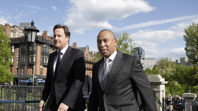 British Prime Minister David Cameron, left, walks with Massachusetts Gov. Deval Patrick into the Massachusetts Statehouse in Boston, Monday, May 13, 2013. Cameron met with Patrick to offer his condolences and discuss lessons that can be learned from the Boston Marathon attacks. (AP Photo/Elise Amendola)