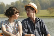 This film image released by IFC Films shows Felicity Jones as Dolly Thatchum, left, and with Luke Treadway as Joseph Pattern in a scene from &quot;Cheerful Weather for the Wedding.&quot; (AP Photo/IFC Films, Suzie Blake)